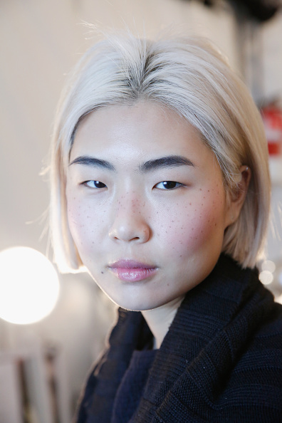 A model poses backstage at the Sandy Liang presentation during Fall 2016 MADE Fashion Week at The Standard on February 14, 2016 in New York City.jpg